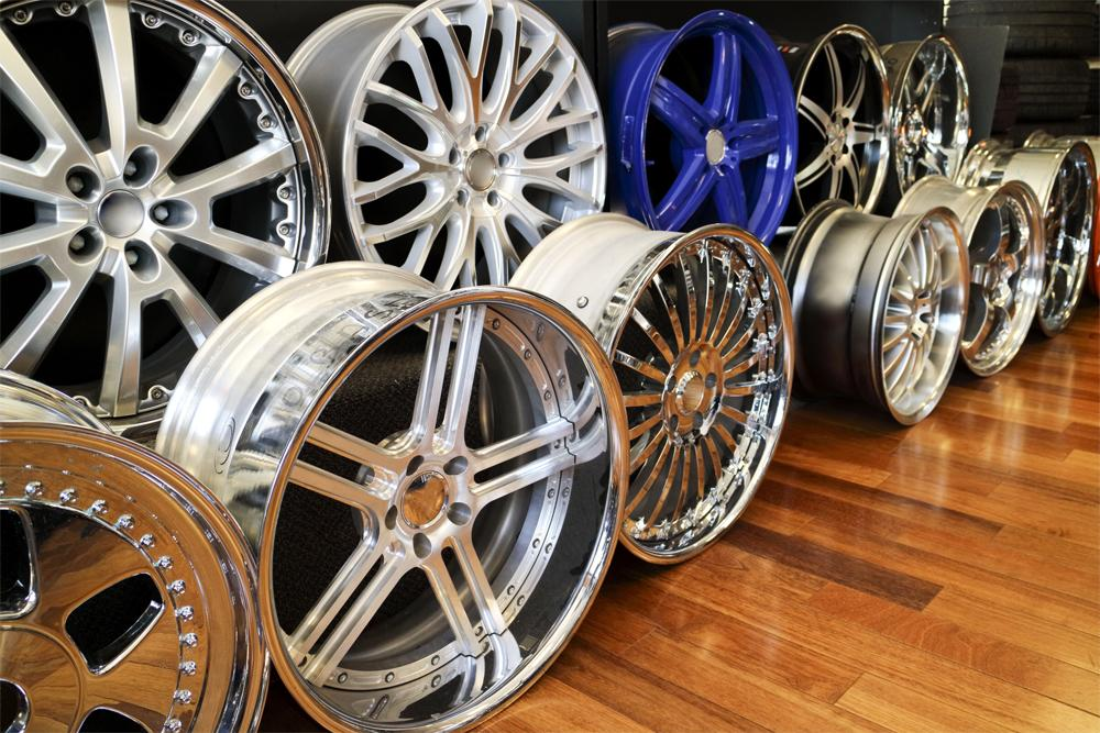 Alloy rims in a row showroom floor, chrome, aluminum Bling