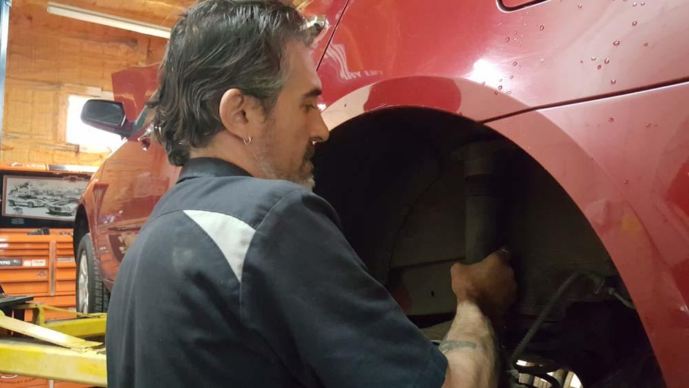 Gibson's Garage tire mechanic